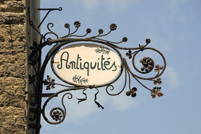 Sign for an antique shop in France